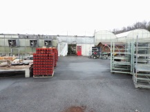 Outside: pallets of pots stored nearby, ready to be brought in when needed. In a few weeks, after it gets warmer, there will be plants on display.